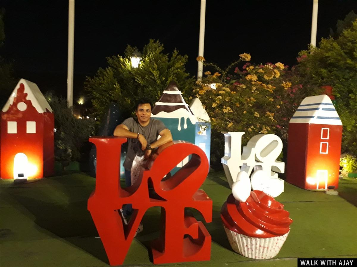 Picture taken with LOVE sign outside Chocolate Ville