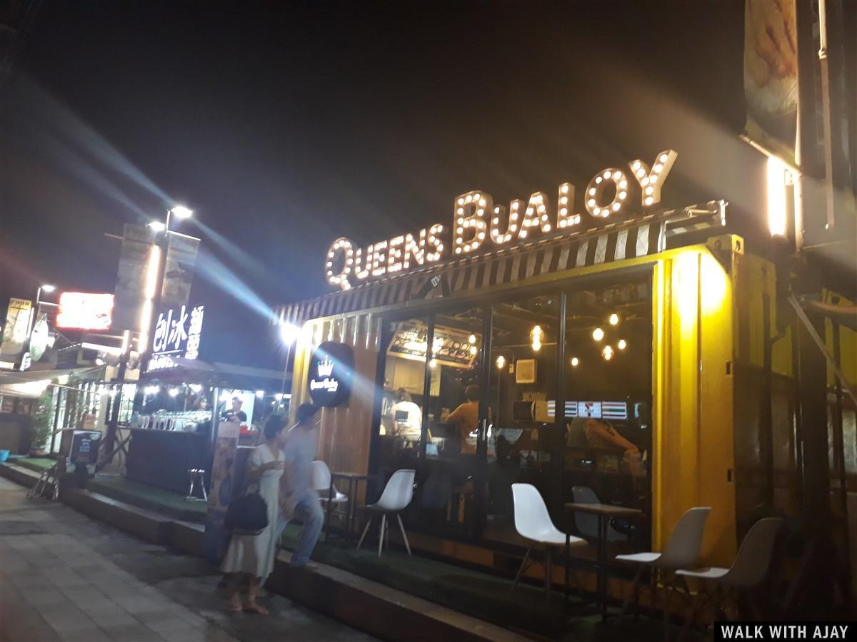 Queens Bualoy shop for food and drinks at street