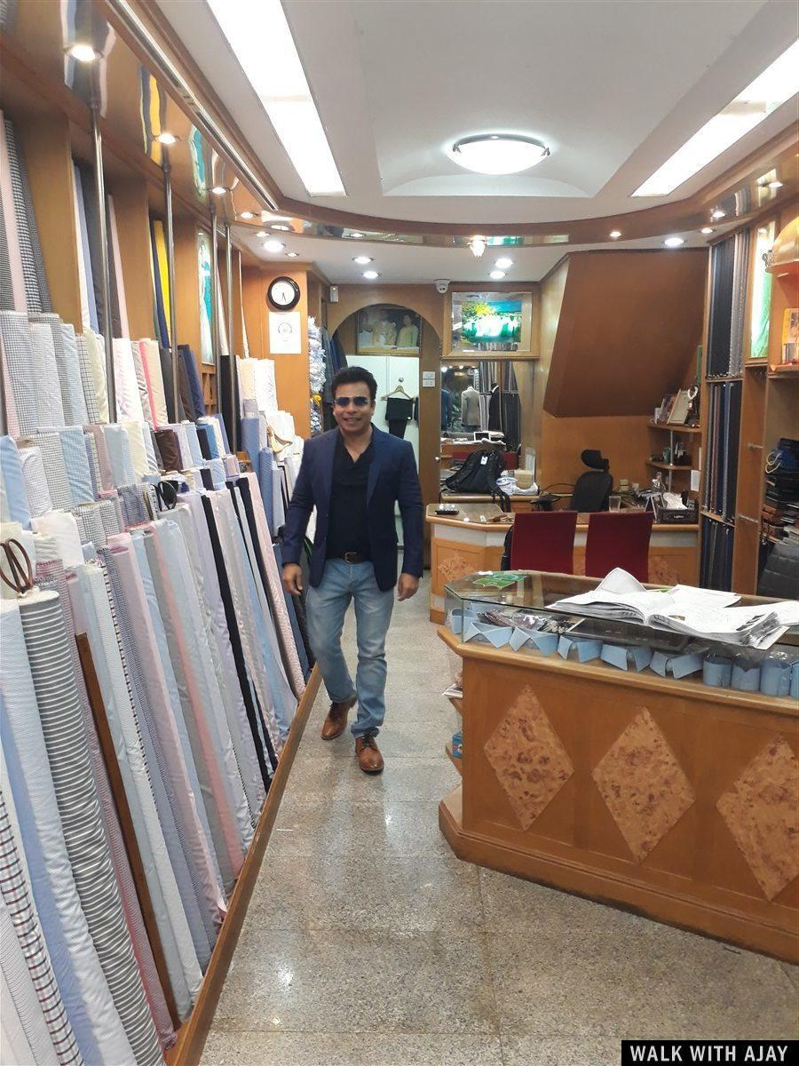 Walking in Tom's Fashion #1 tailoring shop in Bangkok